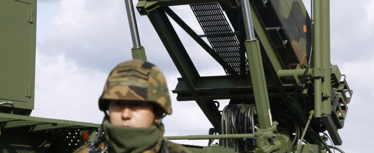 A soldier stands next to a PAC-3 missile unit in Iwate Prefecture, northern Japan