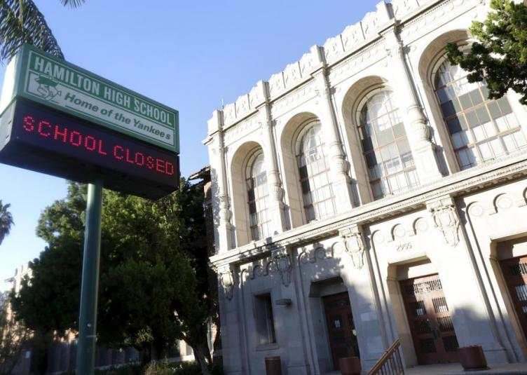 """A sign at Hamilton High School is pictured reading """"School Closed"""" in Los Angeles"""