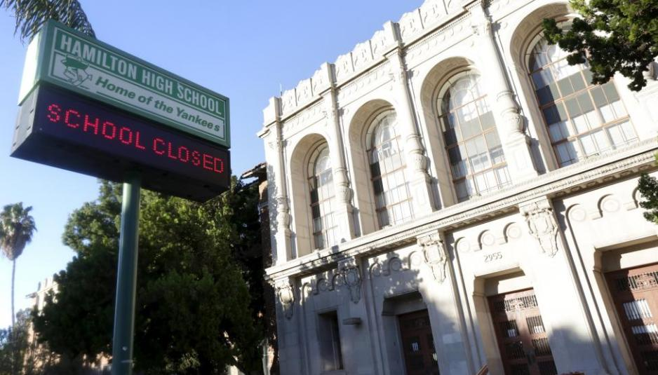 "A sign at Hamilton High School is pictured reading ""School Closed"" in Los Angeles"