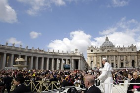 Pope Francis waves to faithful as he is driven through the crowd with his popemobile in St. Peter's Square prior to the start of his weekly general audience at the Vatican, Wednesday, April 10, 2013. (AP Photo/Gregorio Borgia)