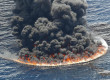 Oil containment efforts are seen at thel site of the Deepwater Horizon oil spill in the Gulf of Mexico,  Sunday, July 11, 2010. (AP Photo/Gerald Herbert)